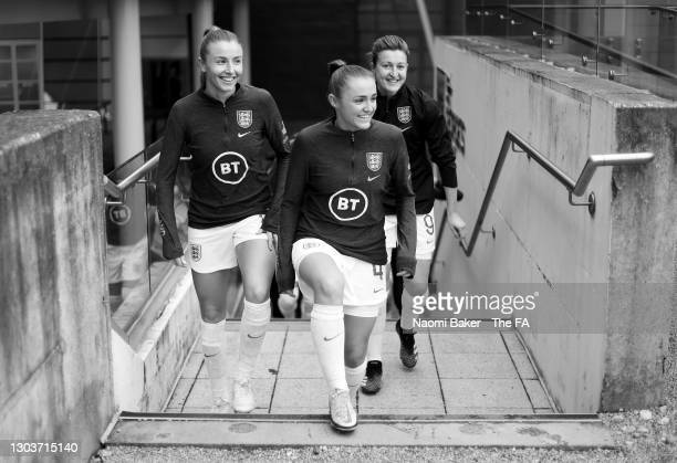 Leah Williamson of England , Georgia Stanway of England and Ellen White of England walk onto the pitch to warm up ahead of the International Friendly...