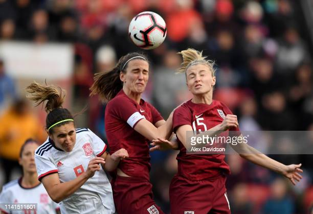 Leah Williamson of England Jill Scott of England and Maria Caldentey of Spain compete for the ball during the International Friendly between England...