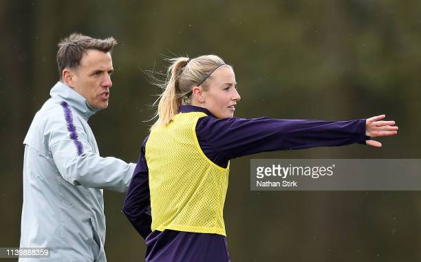 Leah Williamson of England speaks to Phil Neville Manager of England Women during the England Women Training Session at St Georges Park on April 02...