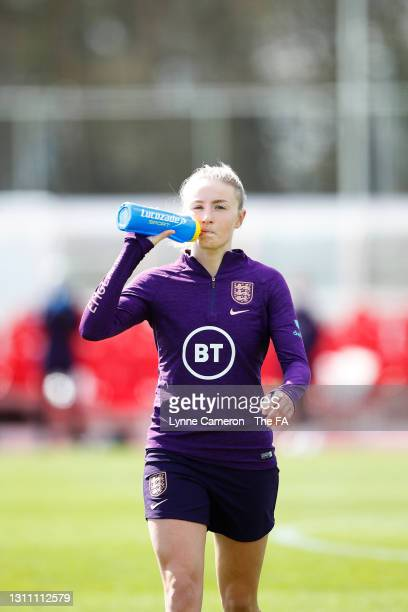 Leah Williamson of England takes a drink from a Lucozade bottle during an England Training Session in preparation for upcoming International matches...