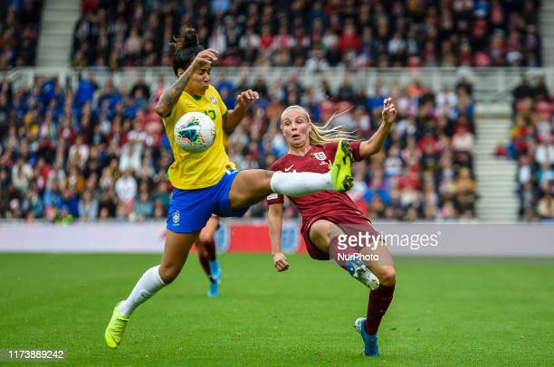 Leah Williamson of England Women battles for possession with Reis Aline of Brazil Women during the International Friendly match between England Women...