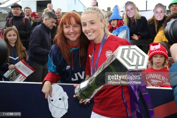 Leah Williamson poses with the trophy alongside her mum during the Women's Super League match between Arsenal Women and Manchester City Women at...