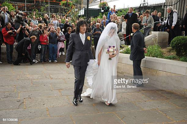 Leah Wood and Ronnie Wood attend her wedding to Jack MacDonald at Southwark Cathedral on June 21 2008 in London England