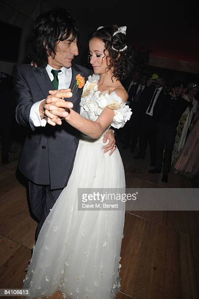 Leah Wood and Ronnie Wood attend the wedding reception of Leah Wood and Jack MacDonald at Holm Wood on June 21 2008 in London England