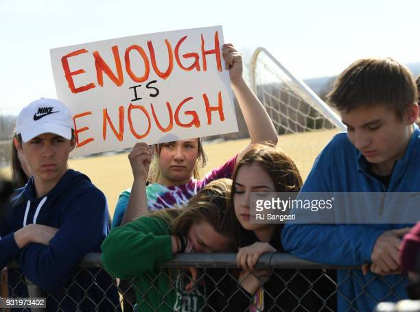Leah Zundel a students at Columbine High School holds a sign that reads 'Enough is Enough' as she and other students walked out of classes in protest...