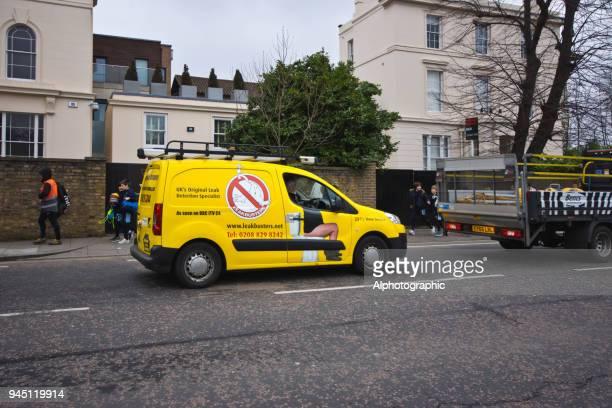 A leakbuster van at traffic lights