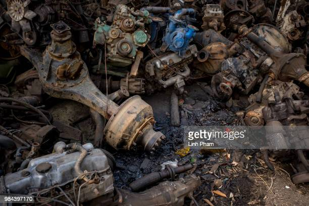 Leaking oil can bee seen over truck parts at a truck scrapyard on June 7 2018 in Dong Van Village Yen Lac District Vinh Phuc Province Vietnam Vietnam...