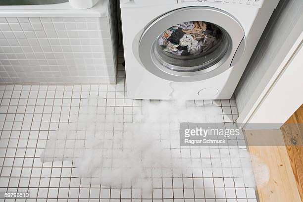 a leaking washing machine - leaking stock pictures, royalty-free photos & images