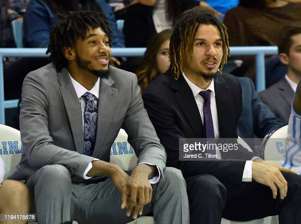 Leaky Black of the North Carolina Tar Heels and Cole Anthony of the North Carolina Tar Heels look on from the sideline during their game at...
