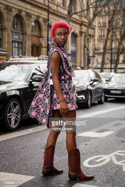 Lean Chihiro wearing pink Paco Rabanne dress mini bag and brown boots outside the Paco Rabanne show during the Paris Fashion Week Womenswear...