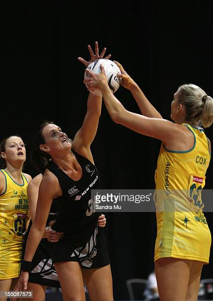 Leana de Bruin of New Zealand defends Catherine Cox of Australia during the 2012 Quad Series match between the New Zealand Silver Ferns and the...