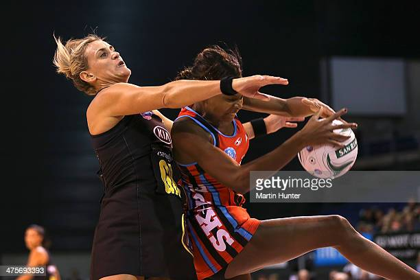 Leana de Bruin of the Magic competes for the ball with Mwai Kumwenda of the Tacix during the round one ANZ Championships match between the Canterbury...
