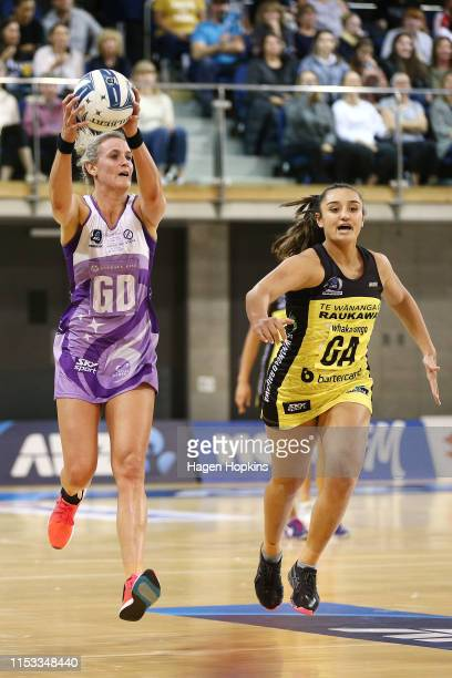 Leana De Bruin of the Stars receives a pass under pressure from Tiana Metuarau of the Pulse during the ANZ Premiership Netball Final between the...