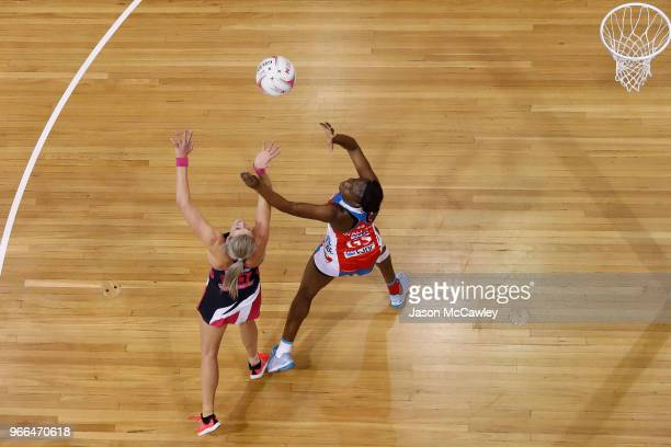Leana De Bruin of the Thunderbirds and Sam Wallace of the Swifts compete for the ball during the round six Super Netball match between the Swifts and...