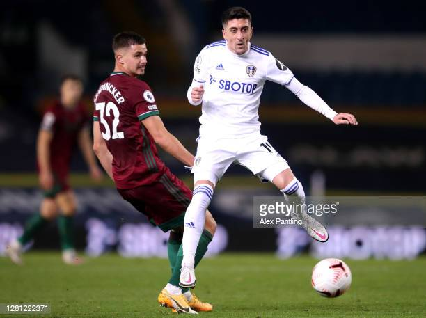 Leander Dendoncker of Wolverhampton Wanderers battles for possession with Pablo Hernandez of Leeds United during the Premier League match between...