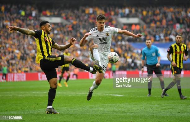 Leander Dendoncker of Wolverhampton Wanderers battles with Andre Gray of Watford during the FA Cup Semi Final match between Watford and Wolverhampton...