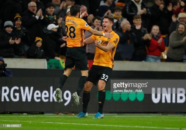 Leander Dendoncker of Wolverhampton Wanderers celebrates after scoring a goal to make it 1-0 with Joao Moutinho of Wolverhampton Wanderers during the...