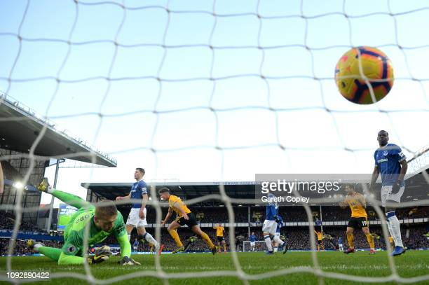 Leander Dendoncker of Wolverhampton Wanderers celebrates after scoring his team's third goal during the Premier League match between Everton FC and...
