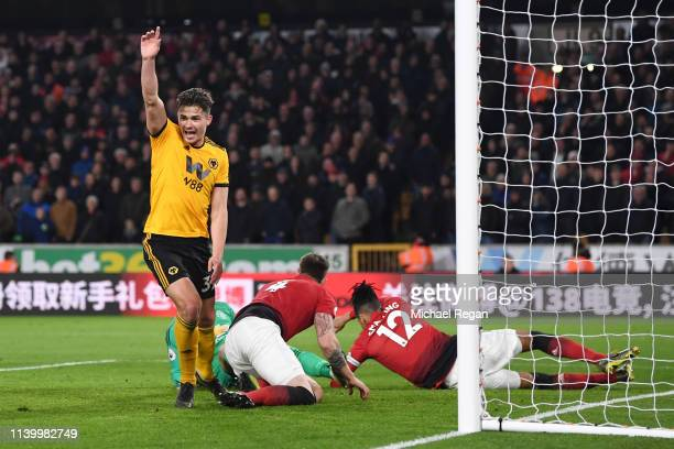 Leander Dendoncker of Wolverhampton Wanderers celebrates after his team's second goal during the Premier League match between Wolverhampton Wanderers...