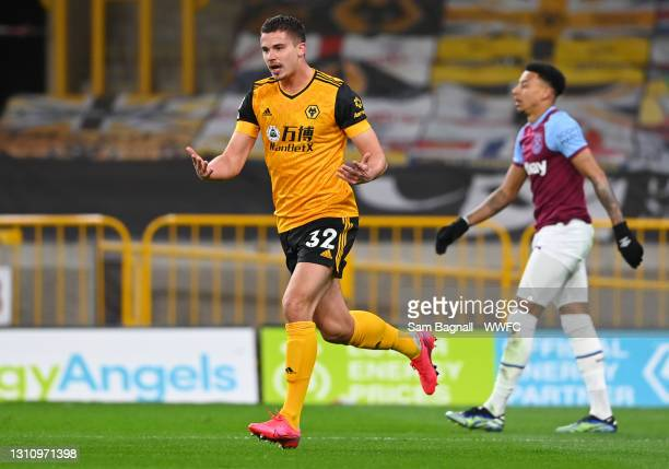 Leander Dendoncker of Wolverhampton Wanderers celebrates after scoring their team's first goal during the Premier League match between Wolverhampton...