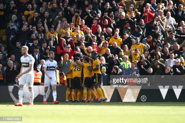 Leander Dendoncker of Wolverhampton Wanderers celebrates with teammates after scoring his team's first goal during the Premier League match between...