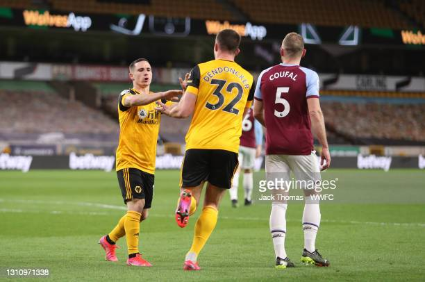 Leander Dendoncker of Wolverhampton Wanderers celebrates with teammate Daniel Podence after scoring their team's first goal during the Premier League...