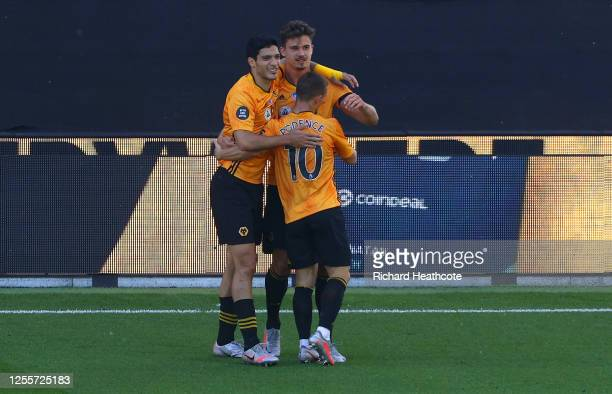 Leander Dendoncker of Wolverhampton Wanderers celebrates with his team after he scores his teams second goal during the Premier League match between...