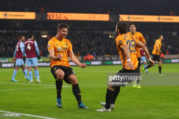 Leander Dendoncker of Wolverhampton Wanderers celebrates with teammate Joao Moutinho after scoring his team's first goal during the Premier League...