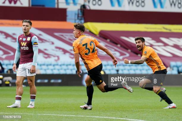 Leander Dendoncker of Wolverhampton Wanderers celebrates with Ruben Neves as Jack Grealish of Aston Villa reacts after scoring his team's first goal...