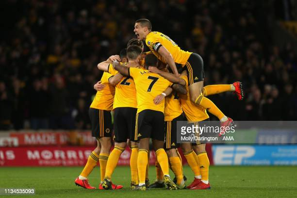 Leander Dendoncker of Wolverhampton Wanderers celebrates with team mates after scoring a goal to make it 21 during the Premier League match between...