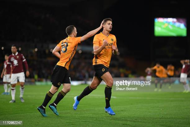 Leander Dendoncker of Wolverhampton Wanderers celebrates with team mate Diogo Jota of Wolverhampton Wanderers after scoring their team's second goal...