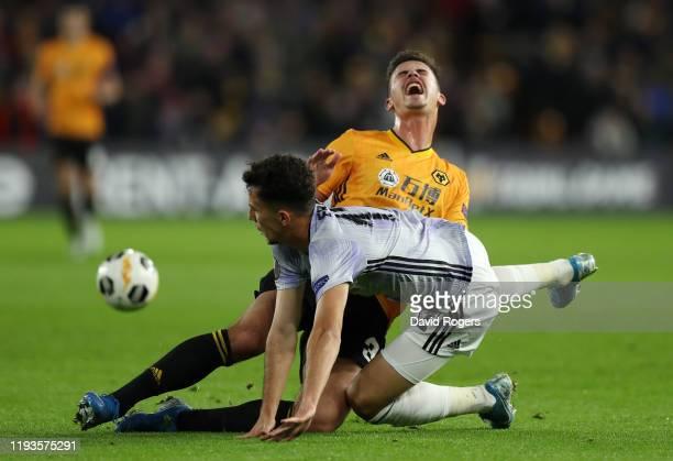 Leander Dendoncker of Wolverhampton Wanderers is challenged by Erdogan Kaya of Besiktas during the UEFA Europa League group K match between...