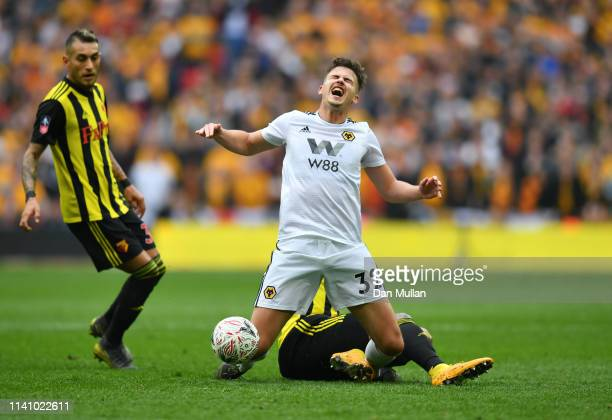 Leander Dendoncker of Wolverhampton Wanderers is challenged by Etienne Capoue of Watford during the FA Cup Semi Final match between Watford and...
