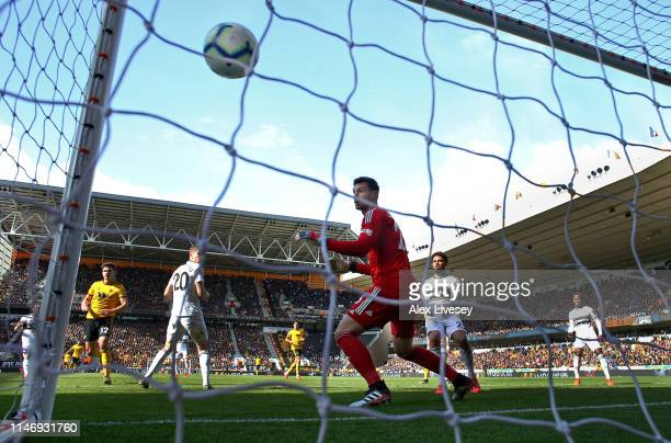 Leander Dendoncker of Wolverhampton Wanderers scores his team's first goal past Sergio Rico of Fulham FC during the Premier League match between...