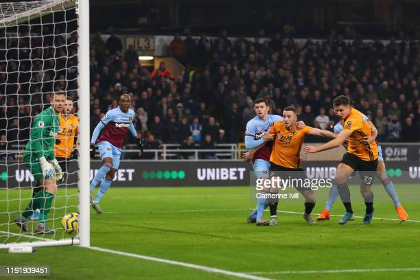 Leander Dendoncker of Wolverhampton Wanderers scores his team's first goal during the Premier League match between Wolverhampton Wanderers and West...