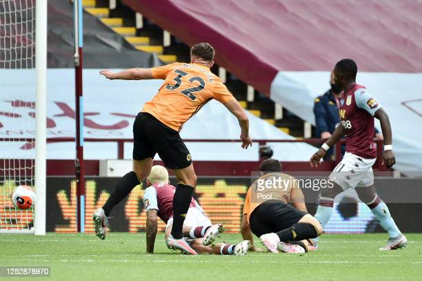 Leander Dendoncker of Wolverhampton Wanderers scores his team's first goal during the Premier League match between Aston Villa and Wolverhampton...
