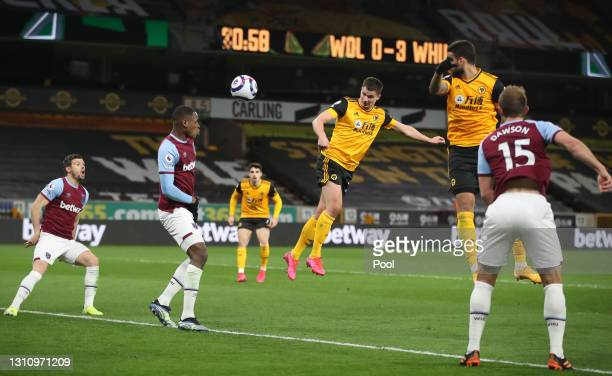 Leander Dendoncker of Wolverhampton Wanderers scores their team's first goal past Issa Diop of West Ham United United during the Premier League match...
