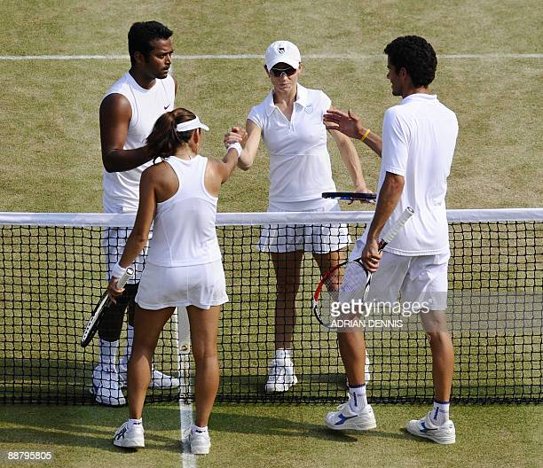 Leander Paes of India and Cara Black of Zimbabwe shake hands with Andre Sa of Brazil and Ai Sugiyama 6-3, 6-3, after their Mixed Doubles match during...