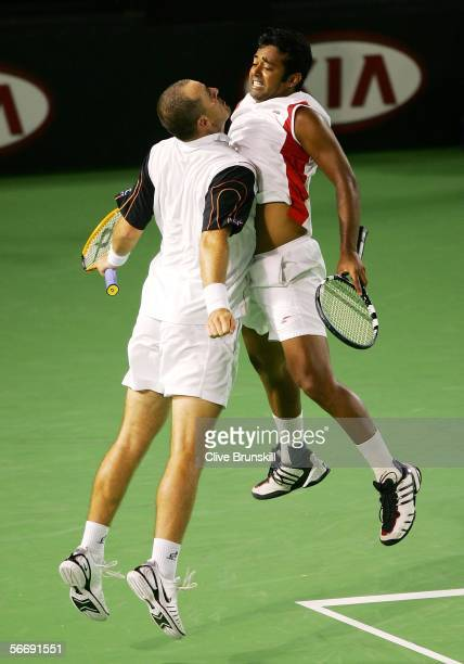 Leander Paes of India and Martin Damm of the Czech Republic celebrate winning a point with a chest bump in their Men's Doubles Final match against...