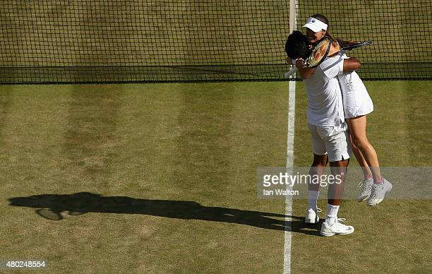 Leander Paes of India and Martina Hingis of Switzerland celebrate in the Mixed Doubles match against Mike Bryan of the USA and Bethanie MattekSands...