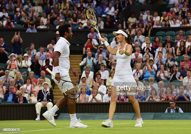Leander Paes of India and Martina Hingis of Switzerland celebrate after winning the Final Of The Mixed Doubles against Timea Babos of Hungary and...