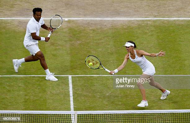Leander Paes of India and Martina Hingis of Switzerland in action in the Final Of The Mixed Doubles against Timea Babos of Hungary and Alexander Peya...