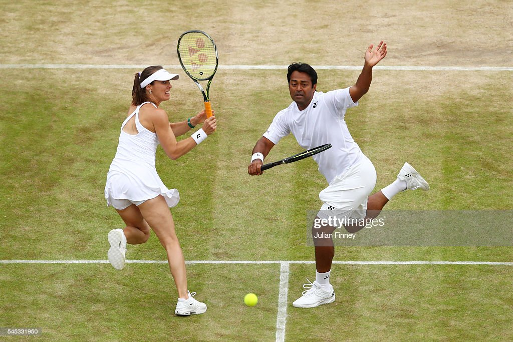 Leander Paes of India and Martina Hingis of Switzerland in acton during the Mixed Doubles third round match against Henri Kontinen of Finland and Heather Watson of Great Britain on day ten of the Wimbledon Lawn Tennis Championships at the All England Lawn Tennis and Croquet Club on July 7, 2016 in London, England.