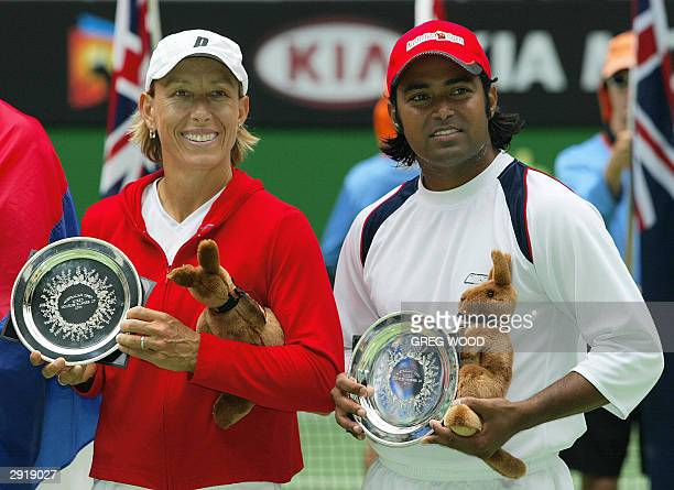 Leander Paes of India and partner Martina Navratilova of the US pose with the runners-up plates following their mixed doubles final against Nenad...