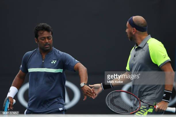 Leander Paes of India and Purav Raja of India talk tactics in their third round men's doubles match against Juan Sebastian Cabal of Colombia and...