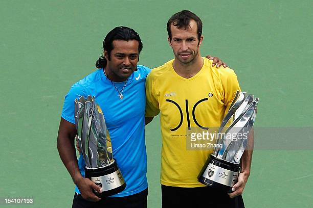 Leander Paes of India and Radek Stepanek of the Czech pose for photographers after defeqating Mahesh Bhupathi and Rohan Bopanna of India during the...