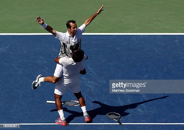 Leander Paes of India and Radek Stepanek of the Czech Republic celebrate winning their men's doubles final against Alexander Peya of Austria and...