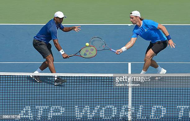 Leander Paes of India left Andre Begemann of Germany return a shot to Guillermo GarciaLopez of Spain and Henri Kontinen of Finland in the men's...