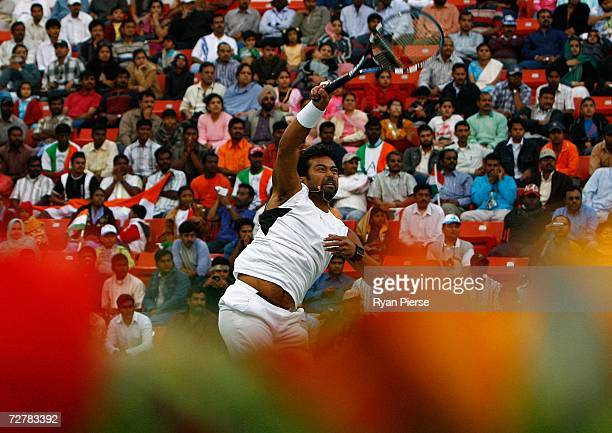 Leander Paes of India plays a smash during his First Round Mixed Doubles match with Sania Mirza of India against Murad Inoyatov and Dilyara...