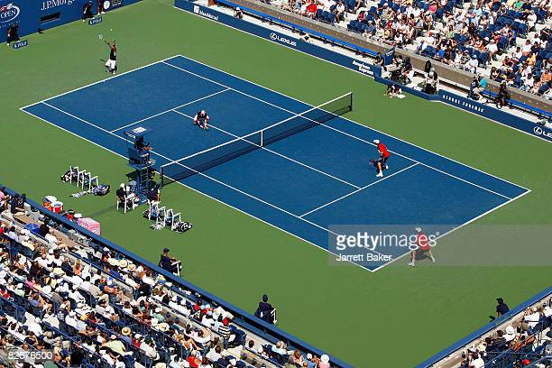 Leander Paes of India serves alongside partner Lukas Dlouhy of the Czech Republic against Bob Bryan and Mike Bryan of the United States compete...